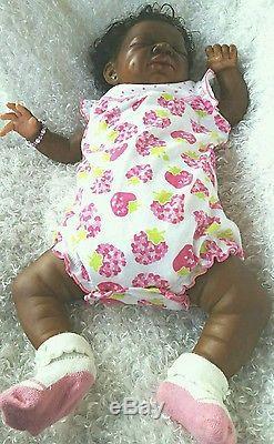 A/A African American newborn dark skintone sleeping reborn doll