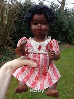 Antique doll black doll mulatto doll brown bisque