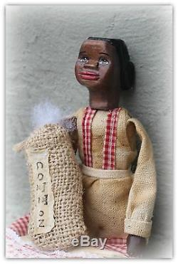 Hand carved African american hitty doll