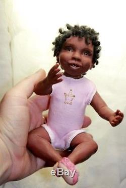 OOAK African American baby girl doll by ALMA Artistry. Polymer clay sculpture