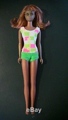 Vintage Black African American redhead Francie Barbie doll with bathing suit